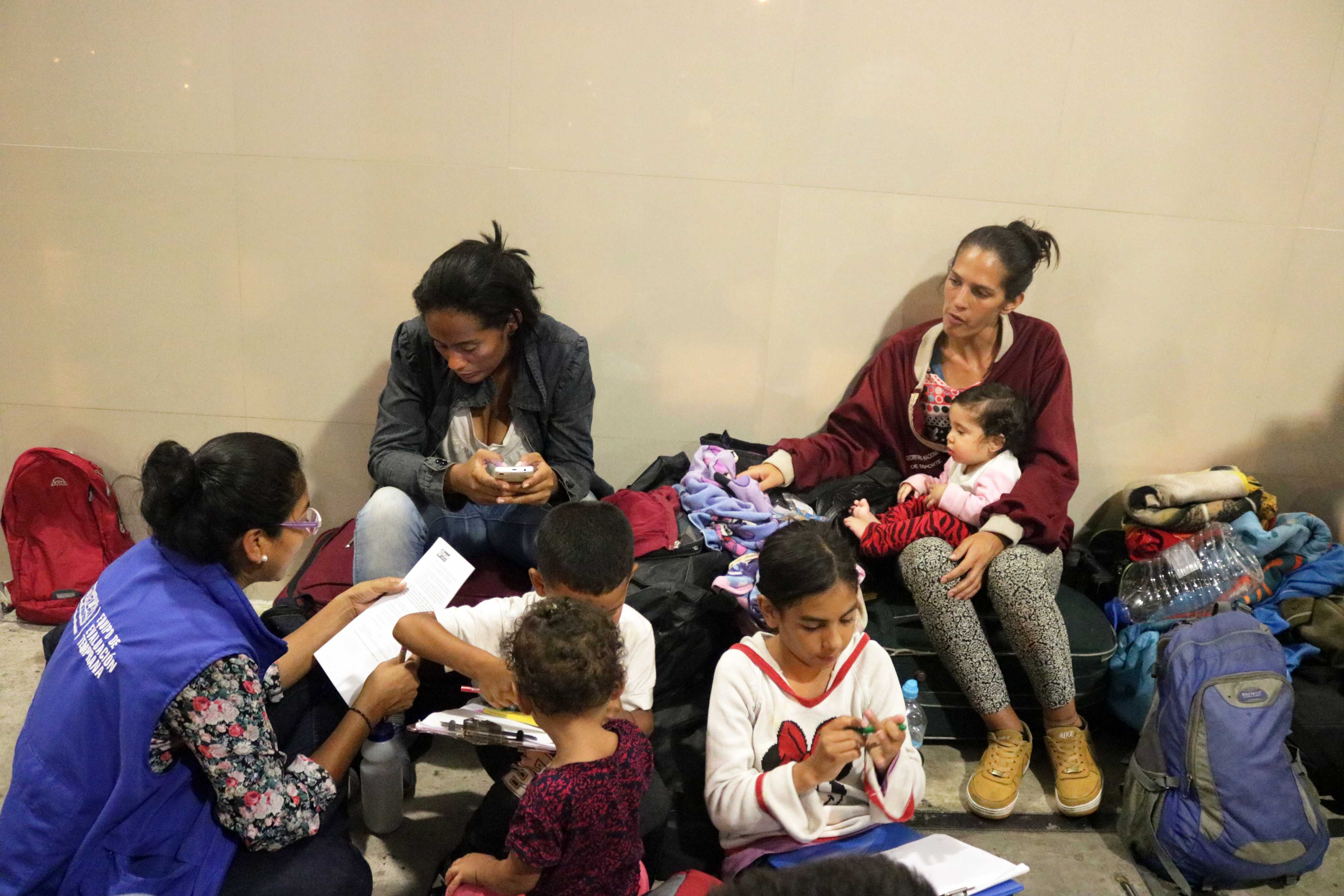 Mothers and children waiting at the border